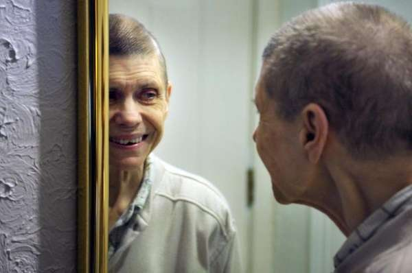 Emma Decker looks into the mirror and smiles