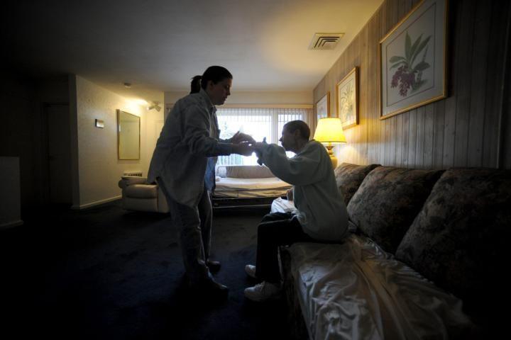 Lynn Decker, left, helps her mom, Emma, rise