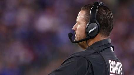 Giants head coach Ben McAdoo looks on during a