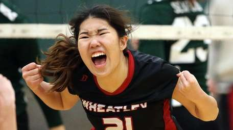 Wheatley's Mary Ma reacts to a point during