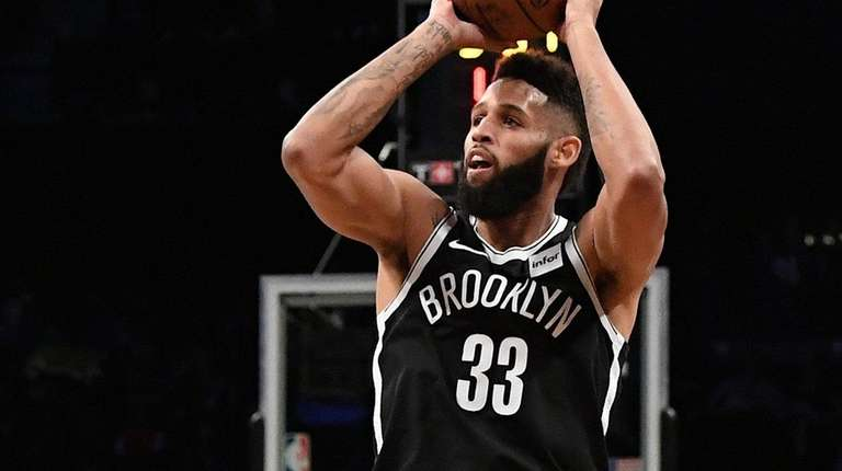 Nets guard Allen Crabbe sinks a three-pointer during