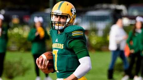 LIU Post quarterback Yianni Gavalas scrambles during a game