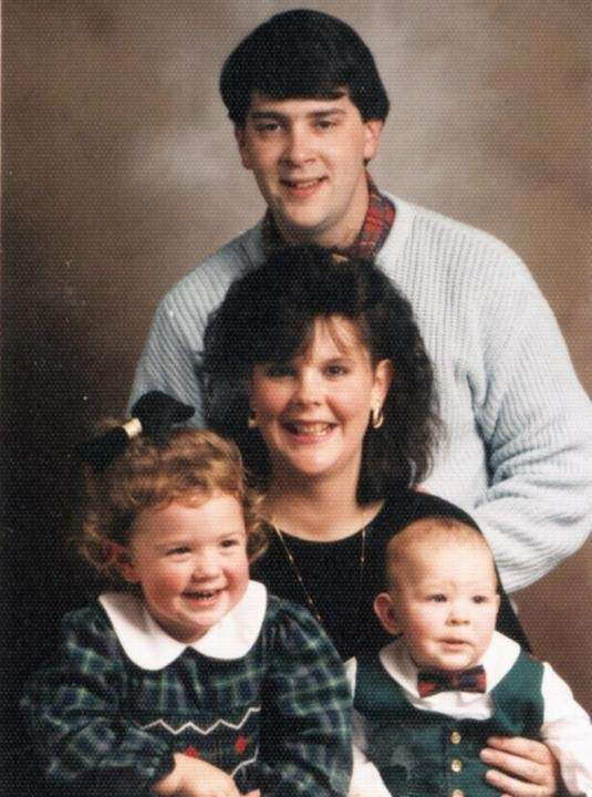 A family photo of the Henleys: Mike, standing,