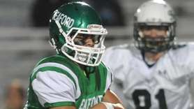 Joe Angelastro #24 of Seaford rushes for a