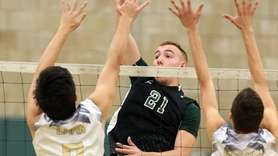 Bellmore JFK's Steven Carlson goes for the kill