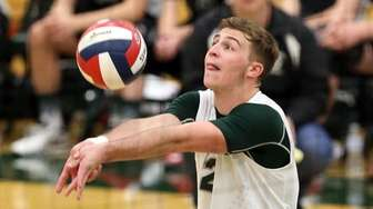 Bellmore JFK's Mitchell Mass with the dig during