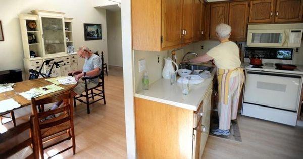 At home in Center Moriches, Harriet Garzero tidies
