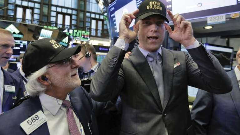 Trader Peter Tuchman, left, and New York Stock