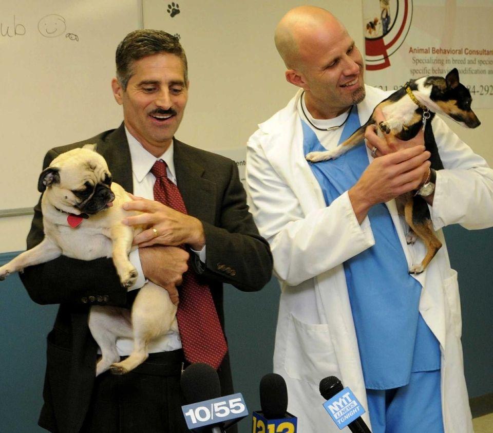 Suffolk County Executive Steve Levy holds a pug
