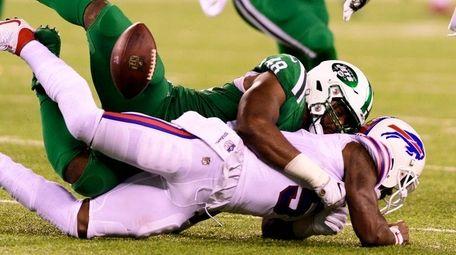 Jets' Jordan Jenkins tackles Bills quarterback Tyrod Taylor,