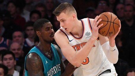Knicks forward Kristaps Porzingis is defended by Charlotte