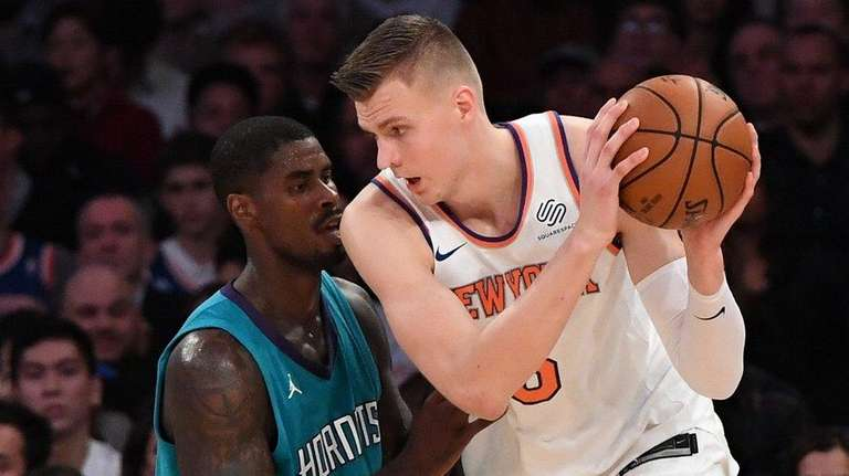 Knicks forward Kristaps Porzingis is defended by Charlotte