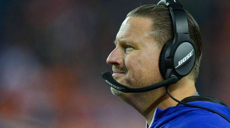 Giants head coach Ben McAdoo looks on during