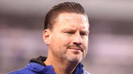 Giants head coach Ben McAdoolooks on after a