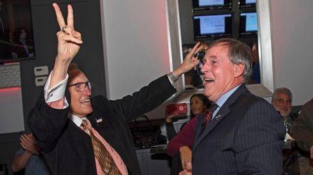 Smithtown Supervisor-elect Ed Wehrheim, right, celebrates his win