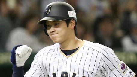 Japan's Shohei Ohtani reacts after hitting a solo