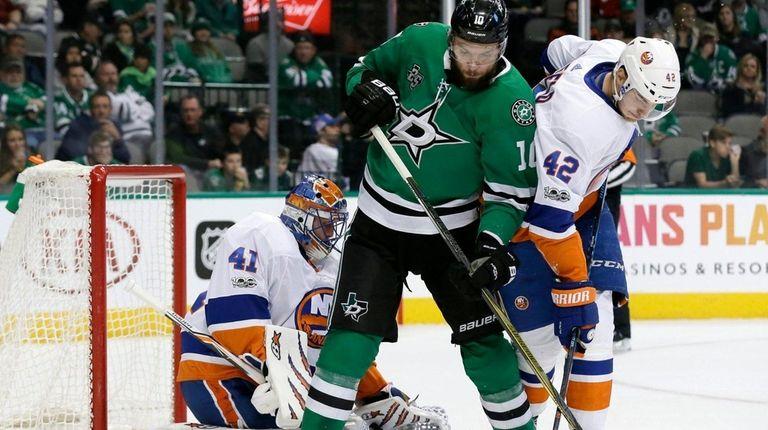 Islanders goalie Jaroslav Halak gloves a shot between