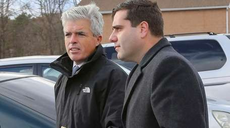 Suffolk County Police Commissioner Timothy Sini, right, with
