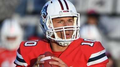 Stony Brook quarterback Joe Carbone passes the ball