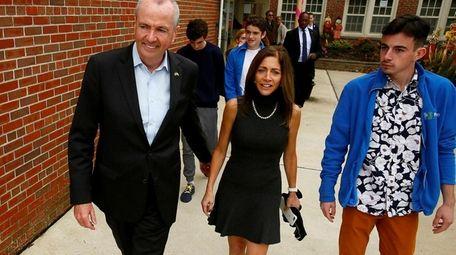 Democrat Phil Murphy leaves Fairview Elementary School in