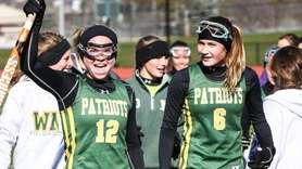 Ward Melville's Kerri Thornton celebrates with teammate Jillian