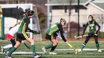 Ward Melville's Kristin Quinn gets ready to pass
