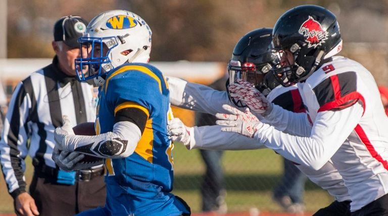 West Islip's Joe Rota (#21) scores a touchdown