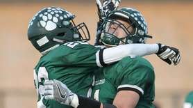 Lindenhurst's Jeremy Ruckert (1) and Mitchel St-Aubin (22)