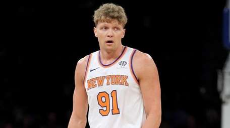 Knicks forward  Mindaugas Kuzminskas reacts during a preseason