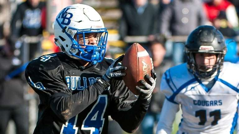 North Babylon's David Estrella hauls in a pass