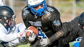 North Babylon's David Estrella (14) runs the ball