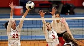 Connetquot's Casandra Patsos (23) and Mackenzie Cole block