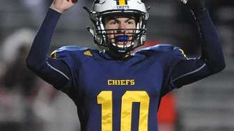 Kenny Galvin #10 of Massapequa reacts after teammate