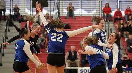 Glenn's girls volleyball team reacts to its win