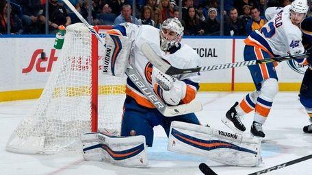 Islanders goaltender Thomas Greissblocks a shot from the