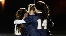 Members of the Massapequa Chiefs celebrate after Kate