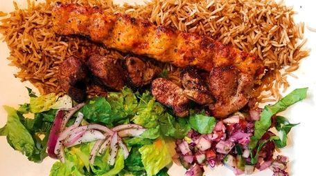 Lamb and kofta kebab over basmati rice at