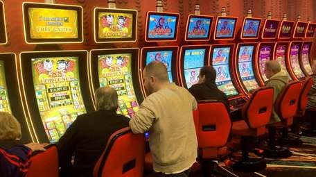 Patrons play the machines at Jake's 58 hotel