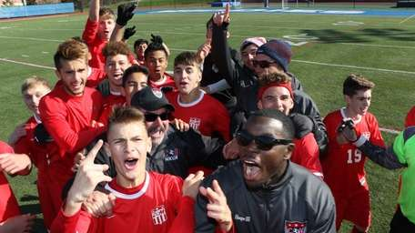 Center Moriches players celebrate after winning the state
