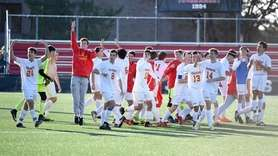 Chaminade boys soccer team celebrates after defeating Regis