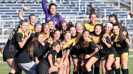 St. Anthony's celebrates after winning the CHSAA state