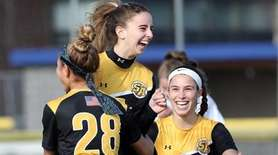 St. Anthony's Lauren Hackett, center, celebrates her goal
