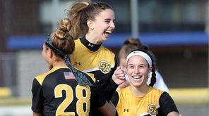 St. Anthony's Lauren Hackett, center, celebrates her goal