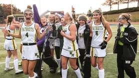 Ward Melville celebrates after winning the state Class