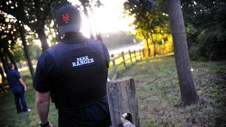 Park Ranger Tom Lohmann patrols a park in