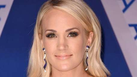 Singer Carrie Underwood co-hosted the 51st annual CMA