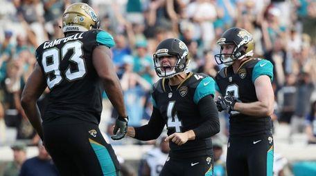 Josh Lambo of the Jaguars celebrates after he