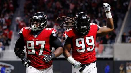 Adrian Clayborn of the Falcons celebrates a sack
