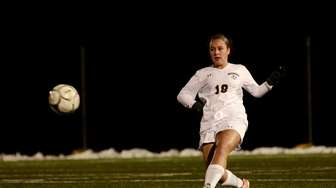 Massapequa's Kirstyn Kilmeade kicks the ball during the