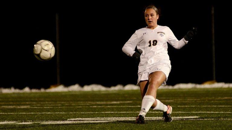 Massapequa's Kirstyn Kilmeade kicks the ball during the